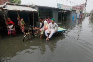 A heavy monsoon rain paralyzed the Dhaka-Narayanganj-Demra (DND) dam areas. Thousands of people living inside the Dhaka-Narayanganj-Demra (DND) dam