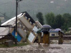 Flood waters wash away the Doru Verinag bridge in Poonch, Jammu and Kashmir (Image by Press Trust of India)