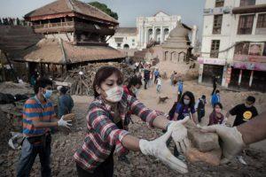 PHOTO: Volunteers continue to clear rubble at the Basantapur Durbar square in Kathmandu. (AFP/Nicolas Asfouri)