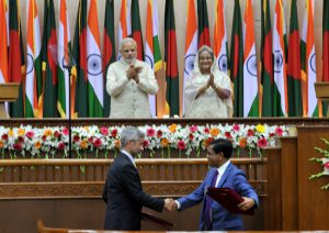 India's Prime Minister Narendra Modi (top left) and Bangladesh's Prime Minister Sheikh Hasina witness the exchange of agreements between the two countries during Modi's recent visit to Dhaka (Image by Press Information Bureau, Government of India)