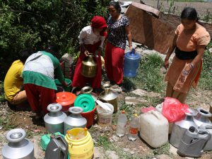 Locals wait for their turn to fill their buckets at Kirtipur. They say supply of drinking water on taps has decreased after the quakes. (Photo: Riwaj Rai)
