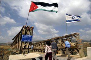 Israeli / Jordanian flags on the wooden bridge over the Yarmouk River (a tributary of the Jordan River) mark the entrance onto the Peace Island. Photo credit: EcoPeace / FoEME