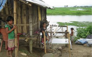 Children in Assam's flooded landscape [image by Mubina Akhtar]