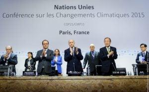 Francoise Hollande, Laurent Fabius and Ban Ki-moon applaud the deal [image by COP Paris]