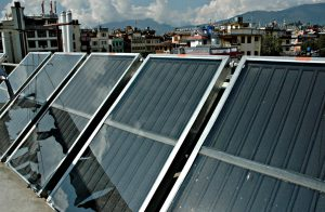 Solar water heating panels in Boudha, Kathmandu. (Image by Wonderlane)