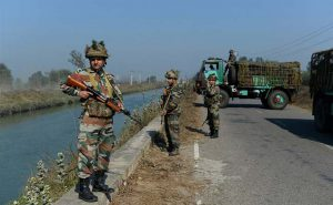 Indian soldiers guard the Munak canal [image by AFP]