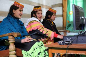 Electricity from micro hydropower projects powers computers in Chitral [image by Sarhad Rural Support Programme]