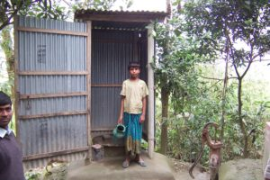A family in Sirajganj district in Bangladesh installing sanitary latrine [image by Development Organization for the Rural Poor]