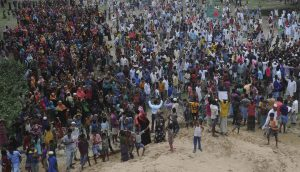 Residents of Gondamara in coastal Bangladesh gather to protest the building of a coal-fired power plant in their village [Image by Minhaz]