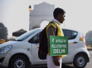 A civil defence volunteer holds a placard in new Delhi (Image: Bi Xiaoyang/Xinhua/Alamy)