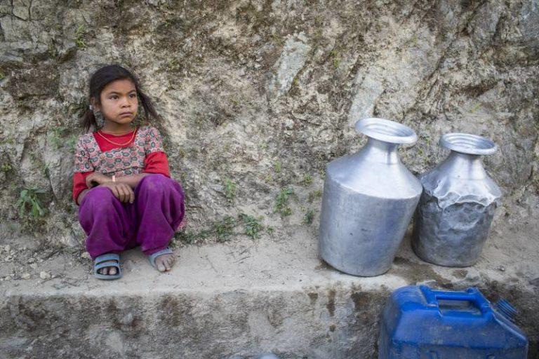 Bishnu Magar awaits her turn to fetch drinking water in Udayapu