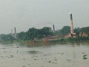 Highly polluting brick kilns on the bank of the Ganga, near Bandel in West Bengal [image by Joydeep Gupta]