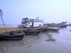 Close to 60 boats are used to build a pontoon bridge as two permanent bridges collapsed because of floods [image by Alok Gupta]