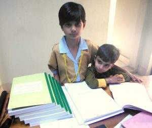 Rabab Ali, with her younger brother [image courtesy Qazi Ali Athar]
