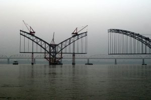 Bridge over the Irrawaddy. Aung San Suu Kyi has created a special commission to evaluate the controversial Myitsone dam on the river (Photo by Sean Ryan)