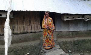 A fisherman's wife on the doorstep on poverty in Bangladesh [image by Zobaidur Rahman]