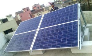 A solar panel installed atop a residents' welfare association office in New Delhi [image from United RWAs Joint Action, URJA Facebook page]