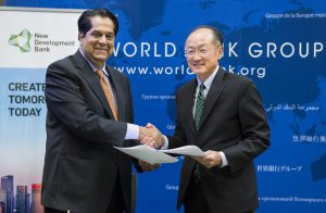 WB President Jim Yong Kim and NDB President K.V. Kamath after signing MoU in September 2016 [image by World Bank]