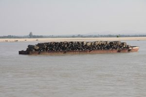 A picture from 2011 of teak logs being floated down the Irrawady [image by Terry Feuerborn]