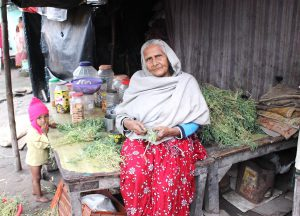 75-year-old Afsa Begum sells biscuits and fryums for kids who come to study in the madrasa housed in a crumbling 15th century mosque complex on the outskirts of Patna, Bihar, where she, her daughter-in-law and two-year-old granddaughter have squatted since years. Her husband is dead and her son left for Mangalore to work for a construction contractor after the severe monsoon floods in 2016. He has sent money only once [image by Manipadma Jena]