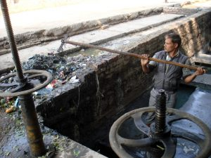 Staff cleaning a choked Intermediate pumping station [image by Juhi Chaudhary]