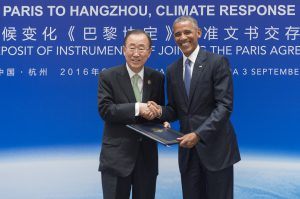 Ban Ki-moon receives the legal instruments for joining the Paris Agreement from Barack Obama at the 2016 G20 summit in Hangzhou, China. [image by UN Photo/Eskinder Debebe]