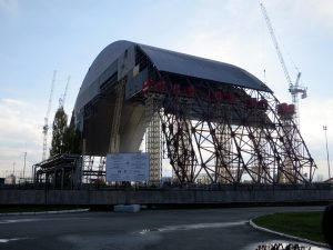 The steel shield constructed over the Chernobyl nuclear reactor will shield the area around it from radioactive dust and parts [image by Stefan Krawsowski]