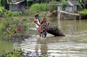 Houses have been flooded in Moulvibazar, Bangladesh, and people are relocating [image by: Serajul Islam]