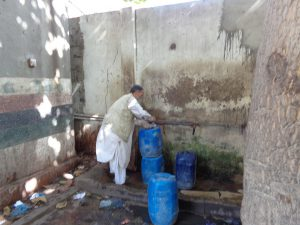 A man sourcing water in South Karachi [image courtesy: PCRWR]