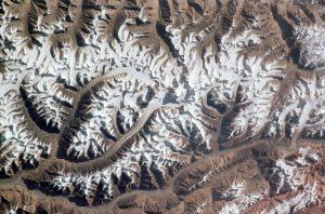 An aeriel view over glaciers in the Karakoram Mountain range [Credit: NASA Johnson]