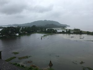 The Brahmaputra (in the background) overflows its banks near Dhubri in Lower Assam during the August 2017 flood [Image by Sucharita Sen]