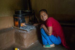 Rupa Tamang cooks food on her improved cookstove. [Image: Nabin Baral]