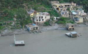 View of Pul Doda from the road above, a half submerged structures of a mosque, a temple and a few houses can be seen [image by: Majod Maqbool]