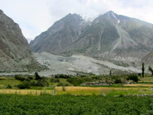 The Hinarchi glacier perches above a village in Bagrote Valley [image by: Rina Saeed Khan]