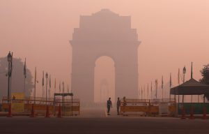 Security personnel stand guard in front of the India Gate amidst the heavy smog in New Delhi [image by:  Reuters]