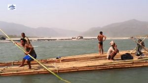 The rafters of Nepal transporting bamboo down the Kosi into India [image by: Nabin Baral]