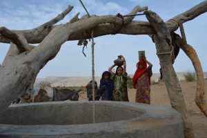 Young girls at a dug well in a remote village near Thano Bula Khan in Jamshoro Dirsticrt near Karachi. Kohistan is an arid region and suffering with severe droughts for many years [image by: Zulfiqar Kunbhar]