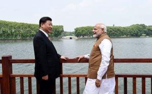 Narendra Modi and Xi Jinping standing along the East laKE