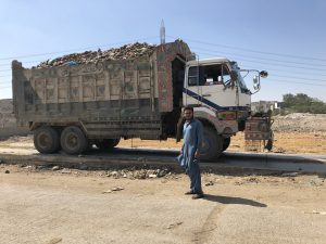 Mohammad Bilal makes two trips from Sharafi goth garbage transfer station to to Jam Chakro landfil site carrying approximately  26 tonnes of waste [image by: Zofeen T Ebrahim]