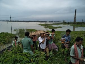 Locals carrying a body of a flood victim in a funeral [image by: Madhav Bhattacharya]