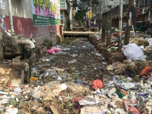 Blocked by trash and plastic, Dhaka's drains are just not capable to dealing the monsoon rains [image by: Masum Molla]