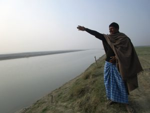 Lal Singh Yadav, a resident of Naika tola fears that soon Ganga ji (Gandak is referred to as Ganga by the local villagers) will wash them away [image by: Nidhi Jamwal]
