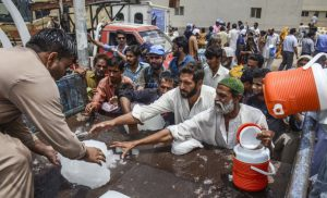 The heatwave in India and Pakistan, which killed thousands in 2015, has been attributed to climate change [image by: Qaisar Khan / Anadolu Agency]