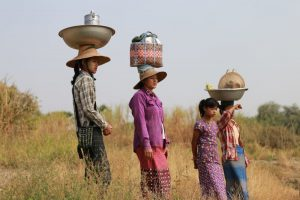 Women in Chaung, Myanmar delivering lunch to farmers