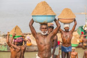 Locals collect sand from the Ghaghara River at the confluence with the Ganga [image by: Nabin Baral]