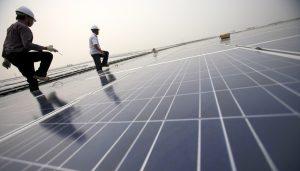 Installing solar panels on Hongqiao train station in Shanghai (Image: Jiri Rezac)