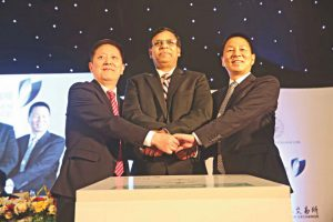 Wang Jianjun, president and CEO of SZSE, and Pan Xuexian, chair of the SSE Supervisory Board, flank the Managing Director of the Dhaka Stock Exchange KAM Majedur Rahman, at the signing of an agreement on 14 May, 2018 [image courtesy: Dhaka Stock Exchange]