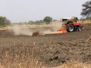Truck ploughing field