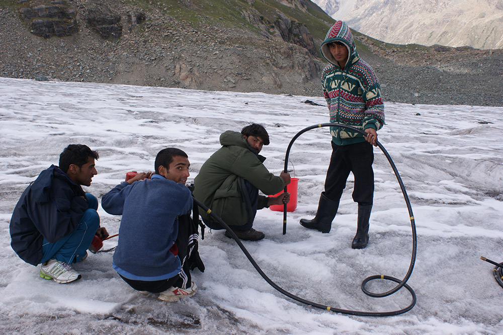 A steam driller machine-is used to insert bamboo sticks which help calculate the thickness of the glacier