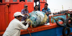 The crew of Holy Star with litter recovered from their nets, Sakthikulangara harbour, Kerala. (Image: Shailendra Yashwant)